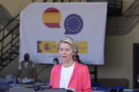 EU Commission president Ursula von der Leyen speaks during a news conference at the Torrejon military airbase in Madrid, Spain, Saturday, Aug. 21, 2021. Top European Union officials visited a Spanish military airport being used as a hub to receive Afghans flown out of Kabul before they are distributed to other countries in the bloc. (AP Photo/Paul White)