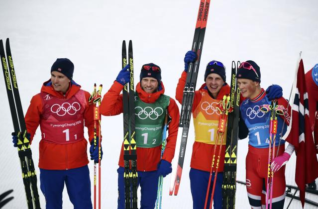 Cross-Country Skiing - Pyeongchang 2018 Winter Olympics - Men's 4x10 km Relay - Alpensia Cross-Country Skiing Centre - Pyeongchang, South Korea - February 18, 2018 - Gold medallists Didirk Toenseth, Johnsrud Martin Sundby, Simen Hegstad Kreuger and Johannes Hoesflot Klaebo of Norway pose. REUTERS/Carlos Barria