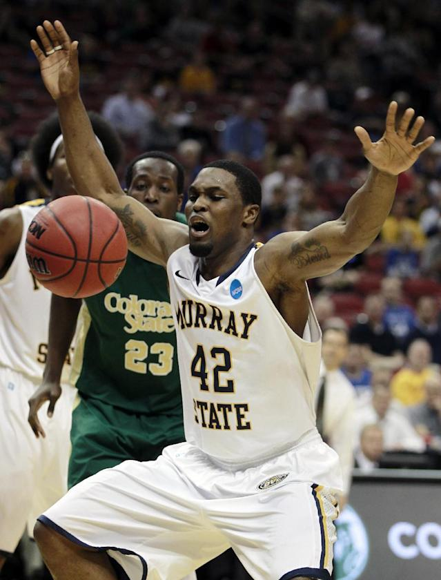 Murray State forward Ivan Aska (42) goes for a loose ball along with Colorado State forward Will Bell (23) in the first half of an NCAA tournament second-round college basketball game in Louisville, Ky., Thursday, March 15, 2012. (AP Photo/John Bazemore)