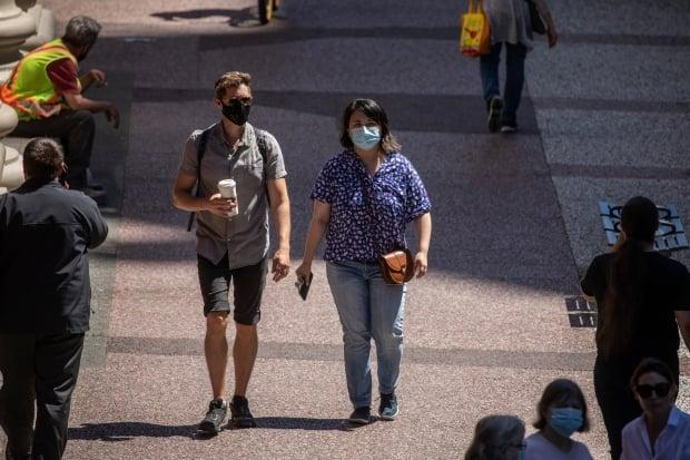 Masked people in downtown Vancouver on June 22.  (Ben Nelms/CBC - image credit)