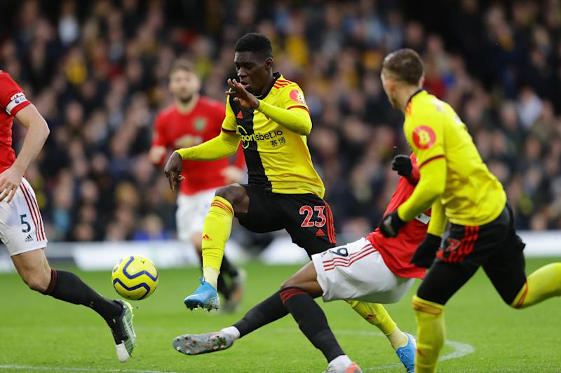 WATFORD, ENGLAND - DECEMBER 22: Ismaila Sarr of Watford is fouled in the area by Aaron Wan-Bissaka of Manchester United which lead to a penalty for Watford during the Premier League match between Watford FC and Manchester United at Vicarage Road on December 22, 2019 in Watford, United Kingdom. (Photo by Richard Heathcote/Getty Images)
