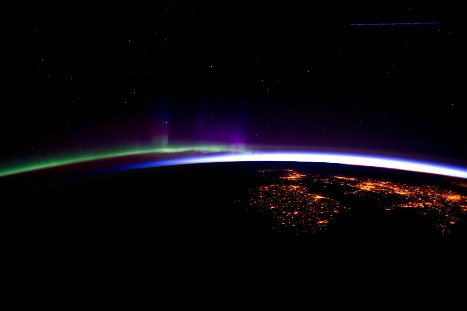 An amazing image released by Nasa shows the UK and Ireland below the stunning greens and purples lights of the Aurora Borealis. The photo was taken on 28 March by the Expedition 30 crew onboard the International Space Station flying at an altitude of about 240 miles over the eastern North Atlantic.