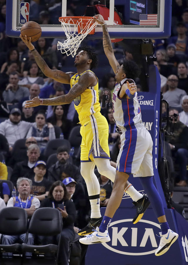 Golden State Warriors' Marquese Chriss, left, lays up a shot against Detroit Pistons' Christian Wood during the first half of an NBA basketball game Saturday, Jan. 4, 2020, in San Francisco. (AP Photo/Ben Margot)