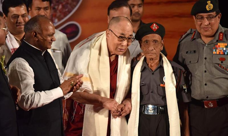 The Dalai Lama shakes hands with Naren Chandra Das