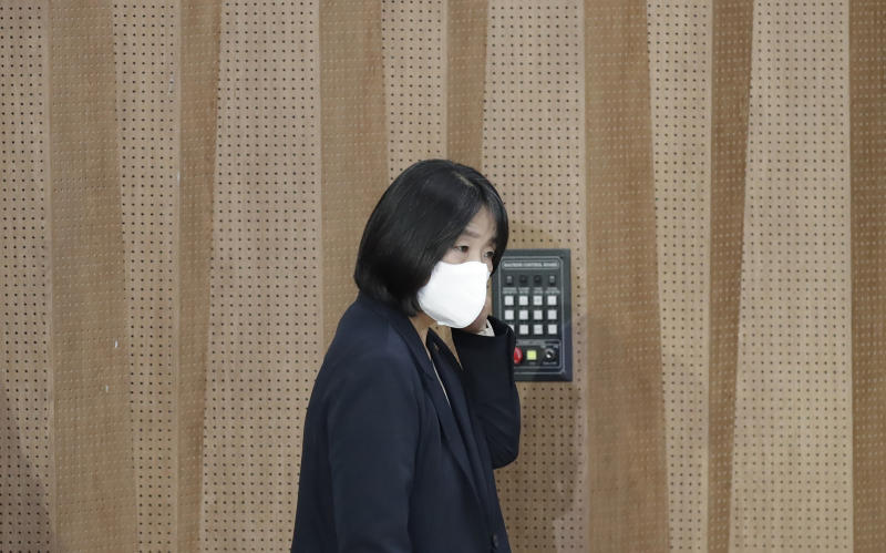 Activist Yoon Meehyang, who begins her four-year term as a lawmaker for the ruling liberal party on Saturday, wearing a face mask, arrives for a news conference at National Assembly in Seoul, South Korea, Friday, May 29, 2020. (AP Photo/Lee Jin-man)