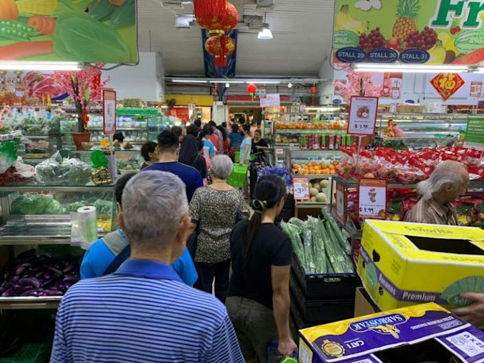 People rushed to stock up on items including rice, noodles and toilet paper, although the government said there was no risk of a shortage (AFP Photo/Martin Abuggao)