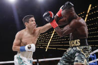 Kazakhstan's Daniyar Yeleussinov, left, punches Reshard Hicks during the first round of a featherweight boxing match Friday, Sept. 13, 2019, in New York. Yeleussinov stopped Hicks in the first round. (AP Photo/Frank Franklin II)