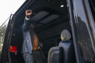 Philonise Floyd, brother of George Floyd, raises his fist to supporters from inside a vehicle after speaking with broadcaster Roland Martin at Black Lives Matter Plaza near the White House in Washington, Tuesday, May 25, 2021. (AP Photo/Carolyn Kaster)