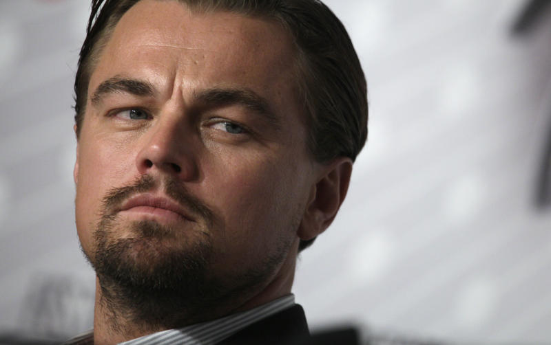 Actor Leonardo DiCaprio listens to questions from journalists during a press conference for the film The Great Gatsby at the 66th international film festival, in Cannes, southern France, Wednesday, May 15, 2013. (AP Photo/Virginia Mayo)