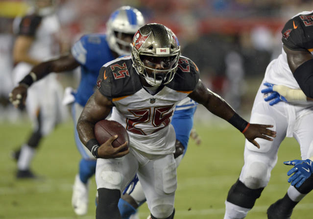 Tampa Bay Buccaneers running back Peyton Barber (25) runs 14-yards for a touchdown against the Detroit Lions during the first half of an NFL preseason football game Friday, Aug. 24, 2018, in Tampa, Fla. (AP Photo/Jason Behnken)
