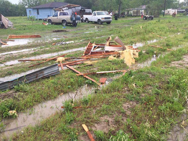 A trailer home where two people were killed after a possible tornado is damaged in Breaux Bridge, St. Martin Parish