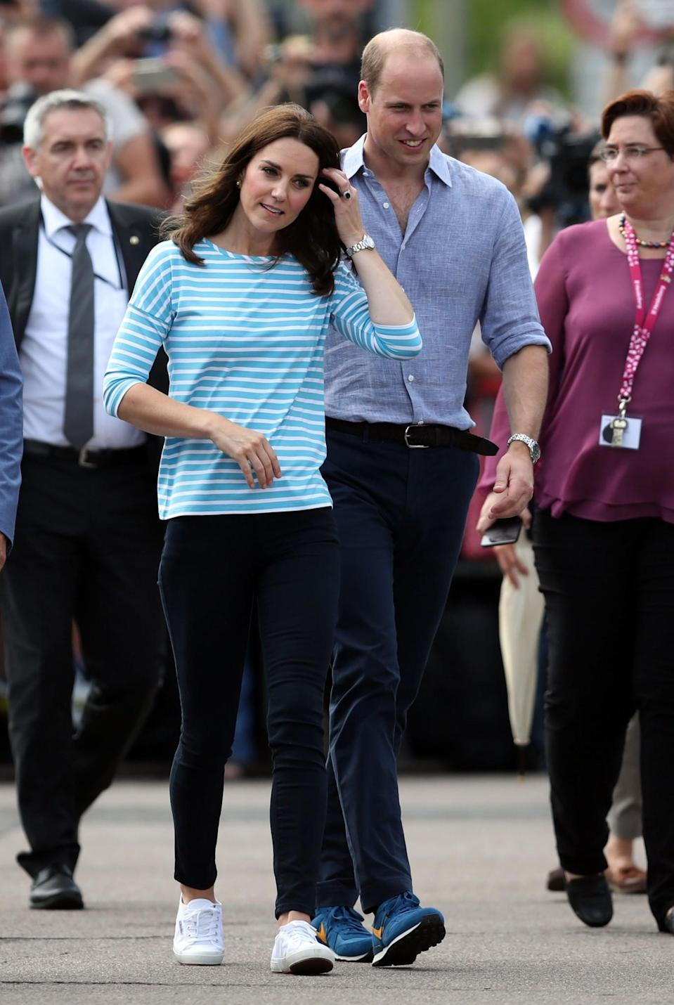<p><b>A boat race saw the Duchess change into a casual, Breton stripe top, dark wash skinny jeans and Superga trainers. <br><em>[Photo: PA]</em> </b></p>
