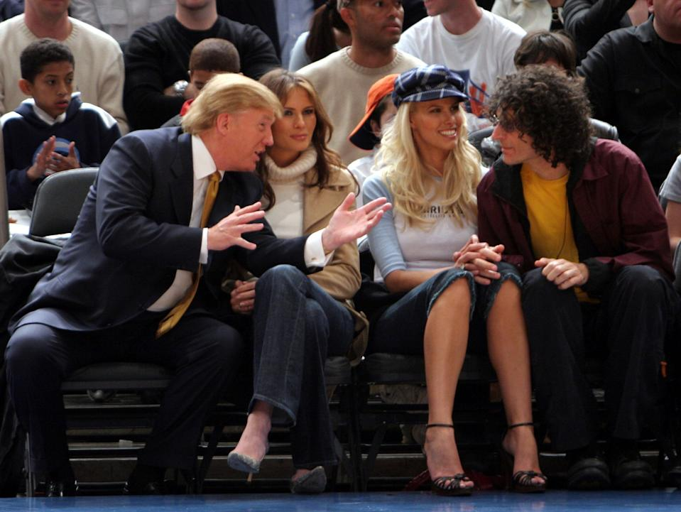 Donald and Melania Trump sit next to Howard Stern and Beth Ostrosky at a New York Knicks game in 2005. (Photo: Getty Images)