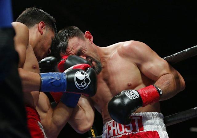 Robert Guerrero, taking a punch from Omar Figueroa on Saturday, announced his retirement at age 34 on Monday after compiling a 33-6-1 record with 18 knockouts. (Getty Images)