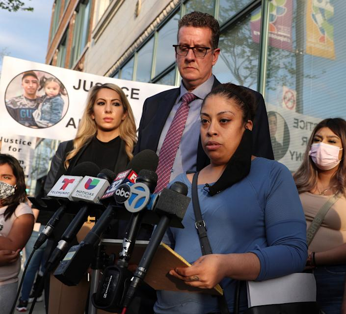 Veronica Alvarez, foreground, the mother of 22-year-old Anthony Alvarez, reads a statement to the media on Tuesday, April 27, 2021, after watching video of her son's fatal shooting.