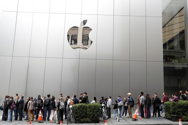People wait in line for the grand opening of the next generation Apple Store in San Francisco, California