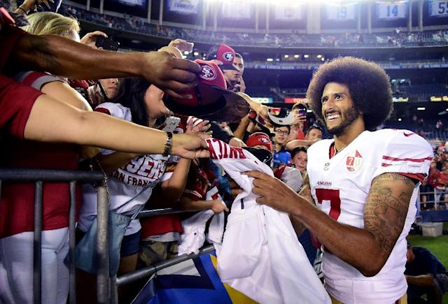 """Colin Kaepernick sat or kneeled for """"The Star-Spangled Banner"""" during exhibition games to protest treatment of African Americans after an off-season of shootings of unarmed black men by police (AFP Photo/Harry How)"""