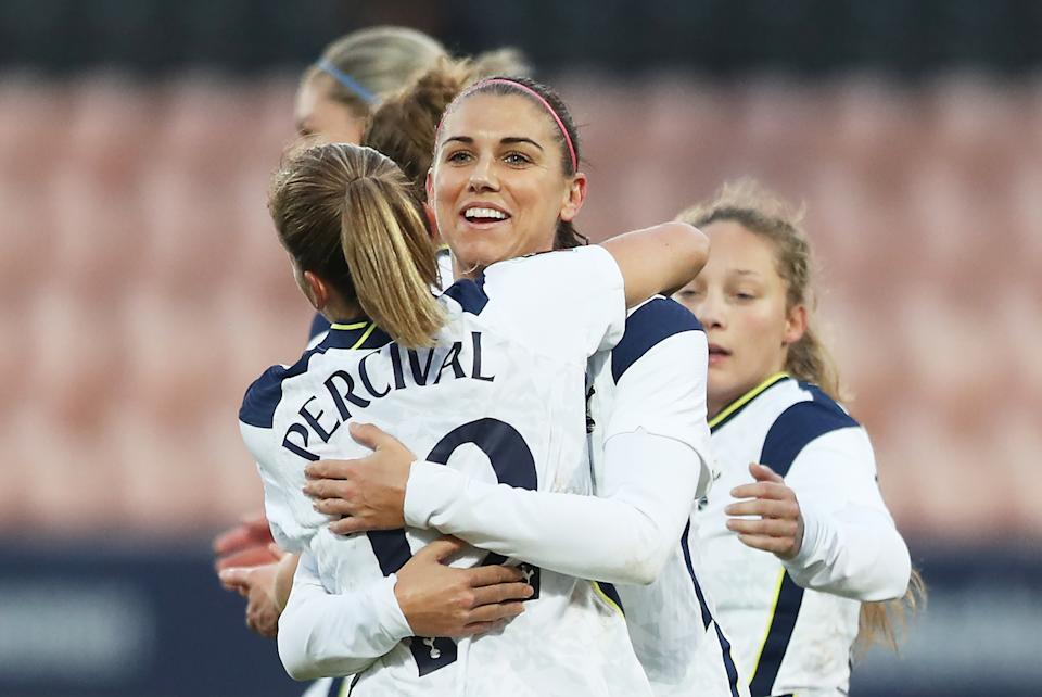 BARNET, ENGLAND - DECEMBER 06: Alex Morgan of Tottenham Hotspur celebrates after scoring her team's third goal from the penalty spot with Ria Percival of Tottenham Hotspur during the Barclays FA Women's Super League match between Tottenham Hotspur Women and Brighton & Hove Albion Women at The Hive on December 06, 2020 in Barnet, England. A limited number of fans are welcomed back to stadiums to watch elite football across England. This was following easing of restrictions on spectators in tiers one and two areas only. (Photo by Naomi Baker/Getty Images)