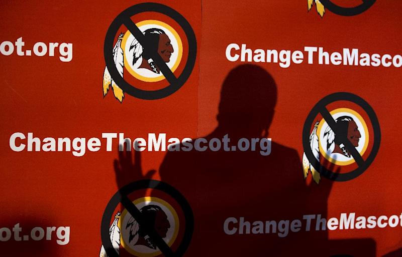 """The shadow of Del. Eleanor Holmes Norton, D-D.C., is cast on the backdrop during the Oneida Indian Nation's Change the Mascot symposium, Monday, Oct. 7, 2013, in Washington, calling for the Washington Redskins NFL football team to change its name. During an interview, President Barack Obama suggested that the owner of the Washington Redskins football team consider changing its name because, the president said, the current name offends """"a sizable group of people."""" (AP Photo/Carolyn Kaster)"""