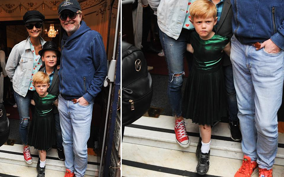 Chris Evans's son Eli, 5, caused a media stir when he went to the theater in London wearing a shiny green dress. (Photo: Getty Images)