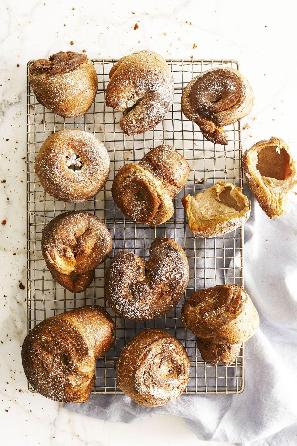 "<p>At <em>GH</em>, we know a thing or two about <a href=""https://www.goodhousekeeping.com/food-recipes/g2882/how-to-make-popovers/"" rel=""nofollow noopener"" target=""_blank"" data-ylk=""slk:popovers"" class=""link rapid-noclick-resp"">popovers</a> — we've been perfecting our recipe for decades! Here, we added a pinch of pumpkin pie spice to give the pastry some fall flair.</p><p><em><a href=""https://www.goodhousekeeping.com/food-recipes/dessert/a40396/pumpkin-popovers-recipe/"" rel=""nofollow noopener"" target=""_blank"" data-ylk=""slk:Get the recipe for Pumpkin Popovers »"" class=""link rapid-noclick-resp"">Get the recipe for Pumpkin Popovers »</a></em></p>"