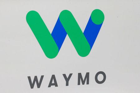 FILE PHOTO: The Waymo logo is displayed during the company's unveil of a self-driving Chrysler Pacifica minivan during the North American International Auto Show in Detroit