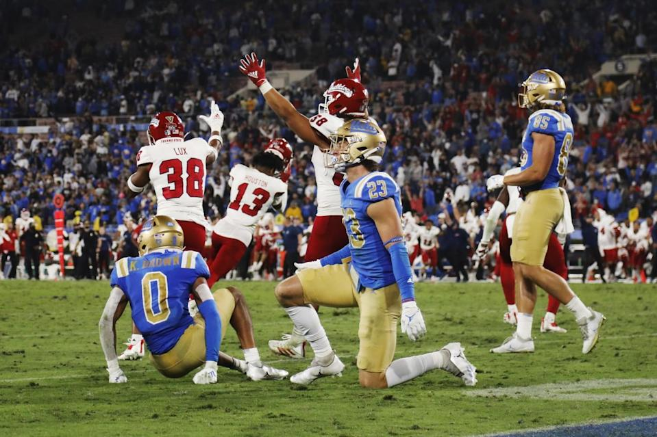 Fresno State celebrates their 40-37 win after a UCLA Hail Mary pass in the final seconds fails to connect.