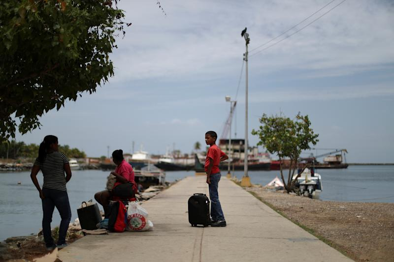 Local residents at a dock at Guiria, Venezuela, on May 23. (Photo: Ivan Alvarado/Reuters)