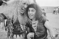 <p>Dee Snider from Twisted Sister and Ronnie James Dio from Rainbow, Black Sabbath, and Dio pose backstage at the Donnington Festival on August 20, 1983.</p>