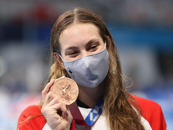 Bronze medallist Penny Oleksiak of Canada poses with her medal during the victory ceremony for the ladies' 200m freestyle final at Tokyo Aquatics Centre