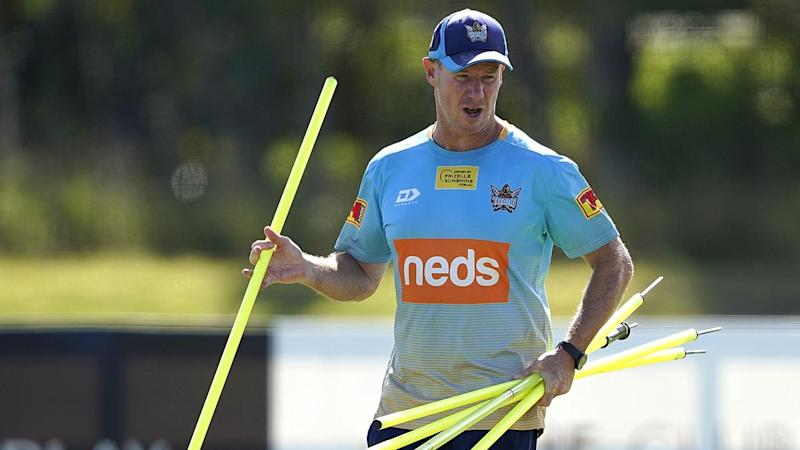 Gold Coast coach Justin Holbrook says his players have either got the flu job or signed the waiver