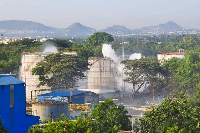 Smokes rise from an LG Polymers plant following a gas leak incident in Visakhapatnam on May 7, 2020. - At least five people have been killed and several hundred hospitalised after a gas leak at a chemicals plant on the east coast of India, police said on May 7. They said that the gas had leaked out of two 5,000-tonne tanks that had been unattended due to India's coronavirus lockdown in place since late March. (Photo by - / AFP) (Photo by -/AFP via Getty Images)