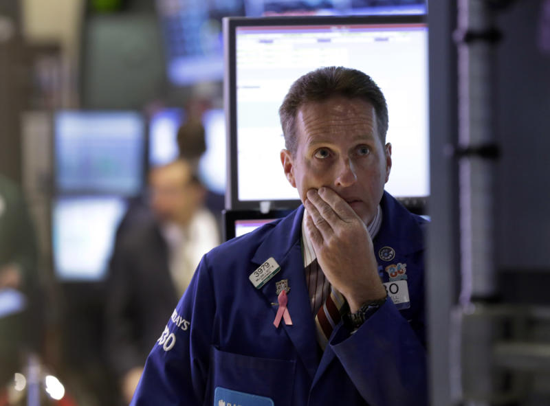 Specialist Glenn Carell works at his post on the floor of the New York Stock Exchange Monday, April 29, 2013.  A pair of encouraging economic reports helped propel the stock market up in early trading on Monday. (AP Photo/Richard Drew)