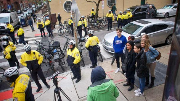 PHOTO: A group of people observe protesters demonstrating outside a Center City Starbucks on April 15, 2018 in Philadelphia, Pennsylvania. (Mark Makela/Getty Images)