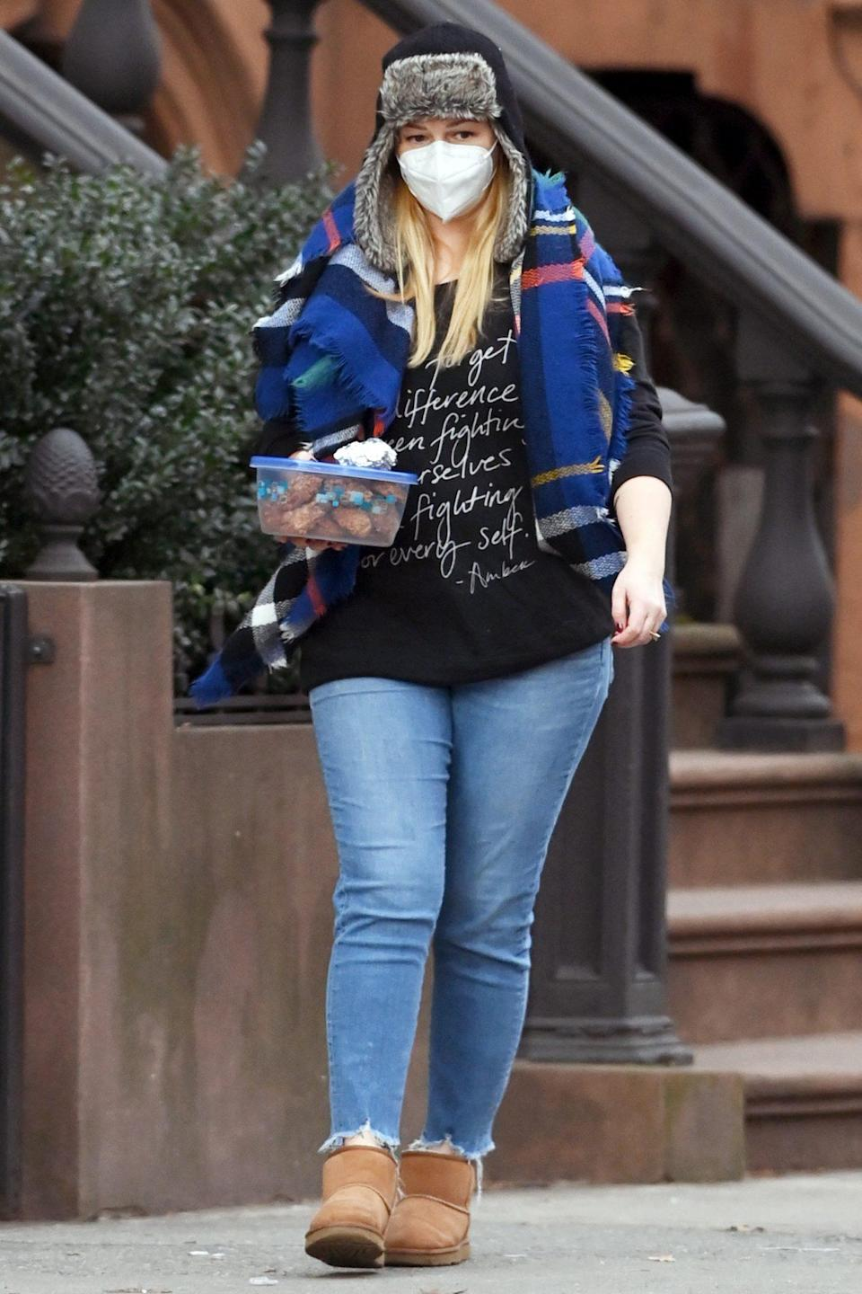 <p>Amber Tamblyn totes some homemade goodies while out in N.Y.C. on Wednesday.</p>