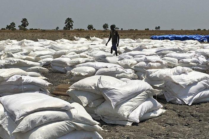 "Bags of food dropped by air from a World Food Program plane are sorted in Padeah, South Sudan. <span class=""copyright"">(Associated Press)</span>"