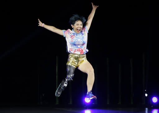 "Kaede Maegawa, a Paralympian, participates in a fashion show dubbed ""Amputee Vinus Show"" in Tokyo on Tuesday, Aug. 25, 2020. The fashion show was held in conjunction with the opening of the Tokyo Paralympic Games, now scheduled to open on Aug. 24, 2021. (AP Photo/Hiro Komae)"