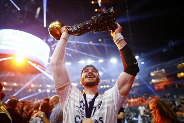 Handball - Men's EHF Champions League Final - HBC Nantes vs Montpellier HB - Lanxess Arena, Cologne, Germany - May 27, 2018. Ludovic Fabregas of Montpellier HB celebrates with the trophy. REUTERS/Thilo Schmuelgen