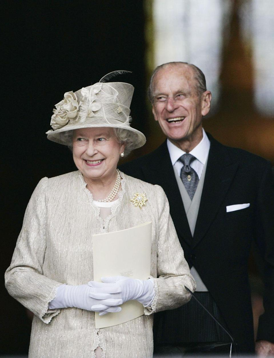 <p>Taking in the wedding celebrations at the marriage of their grandson Peter Phillips to Autumn Kelly at Windsor Castle.</p>