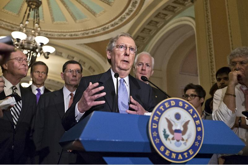 Senate Minority Leader Mitch McConnell of Ky., accompanied by members of the GOP leadership, meet with reporters on Capitol Hill in Washington, Tuesday, June 18, 2013, following a Republican strategy session. From left are, Sen. Lamar Alexander, R-Tenn., Sen. John Thune, R-S.D, Sen. John Barrasso, R-Wyo., McConnell, and Senate Minority Whip John Cornyn of Texas.   (AP Photo/J. Scott Applewhite)