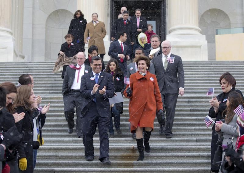 Rep. Xavier Becerra, D-Calif., left, and House Minority Leader Nancy Pelosi of Calif., walk with other House Democrats and immigration leaders to gather on the steps of the Capitol in Washington, Wednesday, March 26, 2014, for a new conference to announce a DemandAVote discharge petition and call on House Speaker John Boehner of Ohio, and the House Republican Conference to bring up immigration reform bill H.R. 15. Also seen is actress America Ferrera, behind and between Pelosi and Becerra. (AP Photo/Carolyn Kaster)