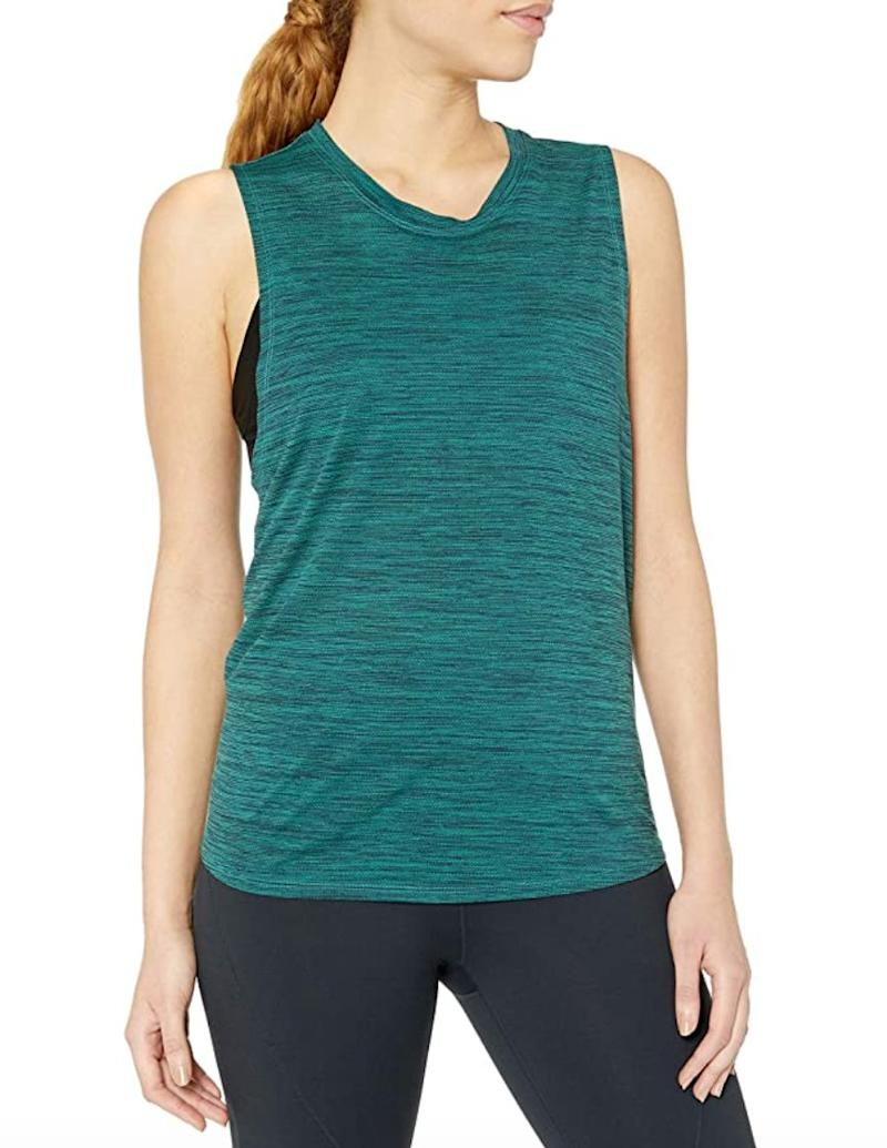 """If you've been looking for a performance tank, you might consider this <a href=""""https://amzn.to/2XXaN2V"""" target=""""_blank"""" rel=""""noopener noreferrer"""">lightweight option</a>. It's meant to be breathable and, thanks to a mesh pattern, moisture-wicking.<br /><br /><strong>Sizes:</strong> This tank comes in sizes XS to 3X.<br /><strong>Rating:</strong> It has a 4.3-star rating over more than 30 reviews. <br /><strong>$$$:</strong> <a href=""""https://amzn.to/3kFIdgc"""" target=""""_blank"""" rel=""""noopener noreferrer"""">Find it starting at $14 on Amazon</a>."""