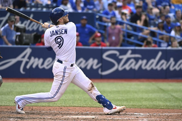 Toronto Blue Jays' Danny Jansen watches his game-ending two-run home run against the Kansas City Royals in a baseball game in Toronto on Saturday, June 29, 2019. (Jon Blacker/The Canadian Press via AP)