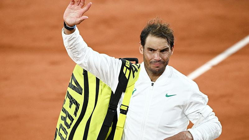 Pictured here, Rafael Nadal waves to fans at the French Open.