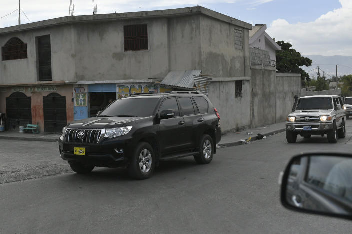 Haiti's first lady Martine Moise is escorted in a caravan of vehicles after returning to Port-au-Prince, Haiti, Saturday, July 17, 2021, ten days after her husband, President Jovenel Moise was assassinated in their home on July 7. (AP Photo/Matias Delacroix)
