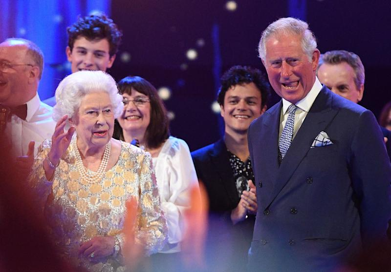 Britain's Prince Charles, Prince of Wales (R) and his mother Britain's Queen Elizabeth II join the performers on stage during The Queen's Birthday Party concert on the occassion of Her Majesty's 92nd birthday at the Royal Albert Hall in London on April 21, 2018. (Photo by Andrew Parsons / POOL / AFP) (Photo credit should read ANDREW PARSONS/AFP/Getty Images)