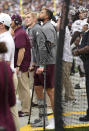 Texas A&M quarterback Haynes King wears a boot on his right leg as he uses crutches to watch the second half of an NCAA college football game against Colorado, Saturday, Sept. 11, 2021, in Denver. King, who started the game for Texas A&M, was injured early in the first quarter. Texas A&M won 10-7. (AP Photo/David Zalubowski)