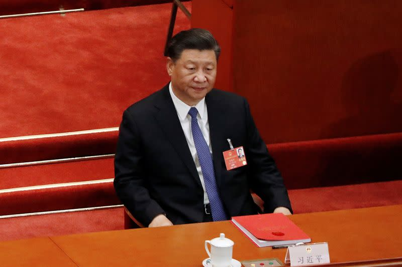 Chinese President Xi Jinping attends the closing session of NPC in Beijing