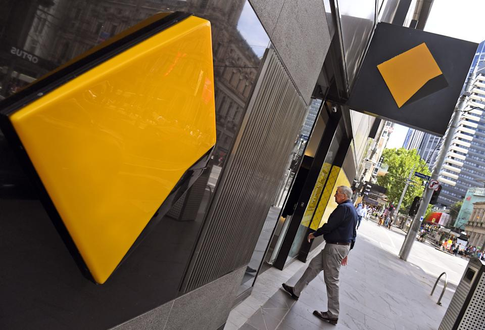 A man walks into a branch of the Commonwealth Bank in Melbourne on February 6, 2019. - Australia's largest financial firm Commonwealth Bank on February 6 said profits fell six percent in the last six months of 2018 amid a