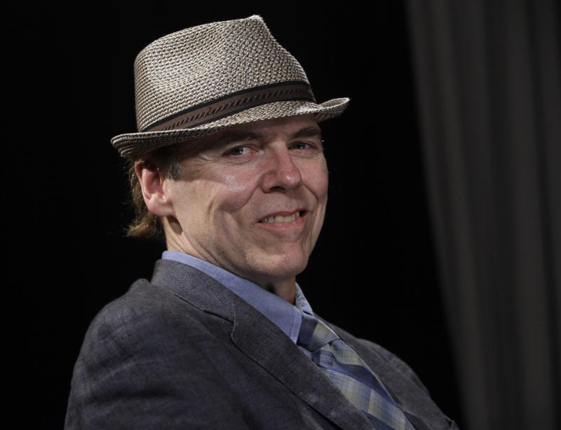 """In this Aug. 16, 2011 photo, singer-songwriter John Hiatt poses for photos, in New York, to promote his latest album, """"Dirty Jeans and Mudslide Hymns.""""  (AP Photo/Richard Drew)"""